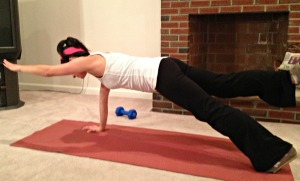 Wide stance plank with opposite arm and leg lift