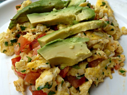 Scrambled eggs with salsa and avocado
