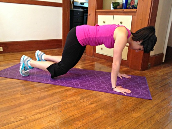 Straight arm plank with knee hover