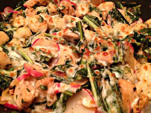 Chicken and gnocchi skillet with dandelion greens, radishes, and oregano