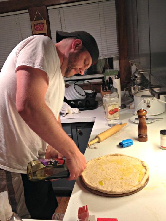 Tim making pizza